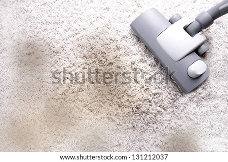 vacuuming - very dirty carpet - stock photo