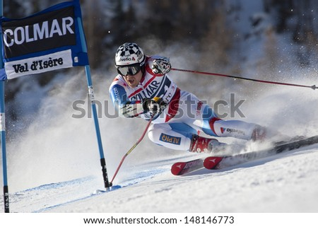 VAL D'ISERE FRANCE. 11-12-2010. BERTHOD Marc (SUI)  attacks a control gate during  the FIS alpine skiing world cup giant slalom race on the Bellevarde race piste Val D'Isere. - stock photo