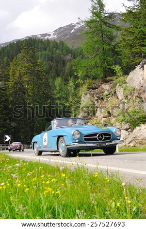 VAL DI POSCHIAVO, SWITZERLAND - JUNE 13: A blue Mercedes 190 SL takes part to the Summer Marathon classic car race on June 13, 2014 in Val di Poschiavo. This car was built in 1961 - stock photo