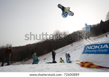 VALCA, SLOVAKIA - FEBRUARY 13: jump of  Klaudia Medlova at Nokia Freestyle Tour 2011 February 13, 2011 in Valca, Slovakia - stock photo
