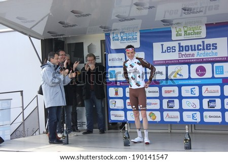 VALENCE, FRANCE - MAR 02: Romain Bardet, winner of La Classic Drome UCI Europe Tour Pro Race receiving flowers in podium on March 02, 2014 in Valence, Drome, France.  - stock photo