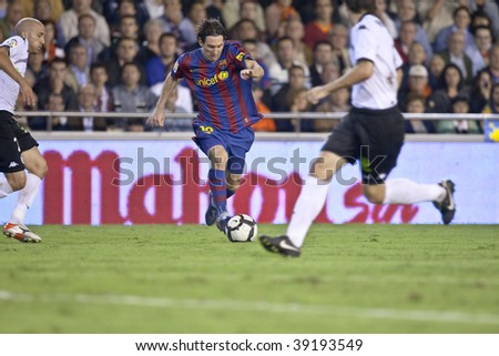 VALENCIA - OCTOBER 17 : Leo Messi (C) of Barcelona FC in action at Spanish soccer league match Valencia C.F. vs F.C. Barcelona at Mestalla Luis Casanova Stadium October 17, 2009 in Valencia. - stock photo