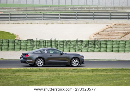 VALENCIA, SPAIN - APRIL 25: A grey 2015 Ford Mustang take part in American Fest weekend organizated in circuit Ricardo Tormo, on April 25, 2015, in Cheste, Valencia, Spain. - stock photo