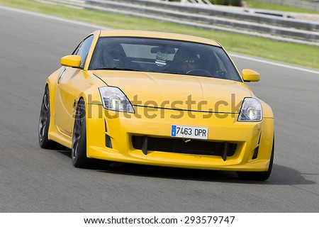 VALENCIA, SPAIN - APRIL 25: A yellow Nissan GTR take part in American Fest weekend organizated in circuit Ricardo Tormo, on April 25, 2015, in Cheste, Valencia, Spain. - stock photo