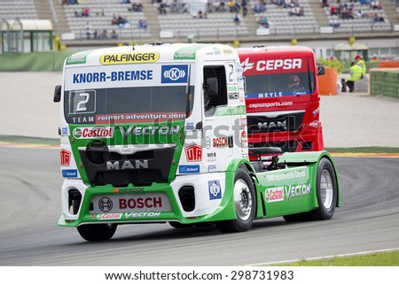 VALENCIA, SPAIN - APRIL 25: European Truck Racing Championship. Jochen Hahn of MAN team compete at Ricardo Tormo circuit, on April 25, 2015, in Cheste, Valencia, Spain. He wins the race. - stock photo