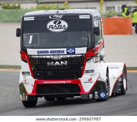 VALENCIA, SPAIN - APRIL 25: European Truck Racing Championship. Norbert Kiss of MAN team compete at Ricardo Tormo circuit, on April 25, 2015, in Cheste, Valencia, Spain. Jochen Hahn wins the race. - stock photo