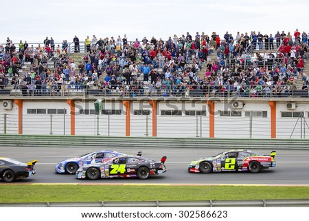 VALENCIA, SPAIN - APRIL 25: Some cars compete at Race 1 Elite 1 of Nascar Whelen Euro Series in Ricardo Tormo circuit, on April 25, 2015, in Cheste, Valencia, Spain. The winner was Eddie Cheever. - stock photo