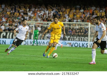VALENCIA, SPAIN - AUGUST 29: Various players in action at the Spanish League game between Valencia CF and Malaga CF at Estadi de Mestalla (Mestalla Stadium) on August 29, 2014 in Valencia, Spain - stock photo