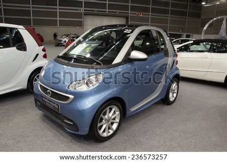 VALENCIA, SPAIN - DECEMBER 4, 2014: A 2014 Mercedes Benz Smart Fortwo Car at the Valencia Automovil 2014 Car Show. The Smart Car comes in two models, a gasoline engine and an electric engine model. - stock photo