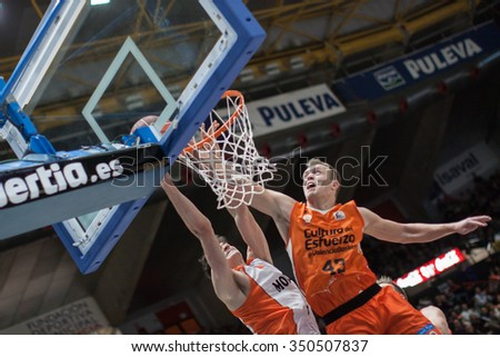 VALENCIA, SPAIN - DECEMBER 12th: Gonzalez (L), Sikma (R) during Spanish League between Valencia Basket Club and Montakit Fuenlabrada at Fonteta Stadium on December 12, 2015 in Valencia, Spain - stock photo