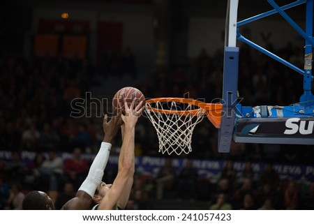 VALENCIA, SPAIN - DECEMBER 30: Various players during Spanish League match between Valencia Basket Club and Juventut at Fonteta Stadium on December 30, 2014 in Valencia, Spain - stock photo