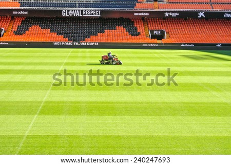 VALENCIA, SPAIN - DECEMBER 14: View of a lawn mower in the Mestalla Stadium. This football stadium has a capacity for 55,000 spectators. December 14, 2014 in Valencia, Spain  - stock photo