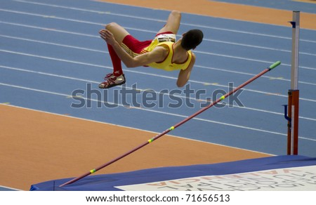 VALENCIA, SPAIN - FEBRUARY 20: High jump competitor of high jump Men of the spanish indoor national championships at Valencia on February 20, 2011 in Valencia, Spain - stock photo