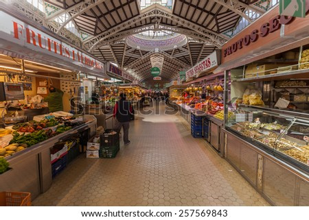 VALENCIA, SPAIN - FEBRUARY 10, 2015: market hall Mercado Central with unidentified people. Built in architectural style of Modernisme its considered one of the oldest European markets still running - stock photo