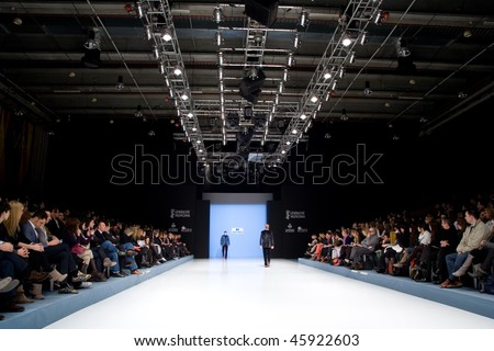 VALENCIA, SPAIN - FEBRUARY 3:  Models on the catwalk wear a Paco Roca design for the Valencia Fashion Week on February 3, 2010 in Valencia, Spain. - stock photo