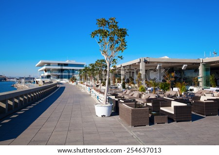 VALENCIA, SPAIN - FEBRUARY 08, 2014: modern visitors center, called -Veles et Vents- of the 32. Americas Cup that was held up in the year 2007. The building was designed by David Chipperfield. - stock photo