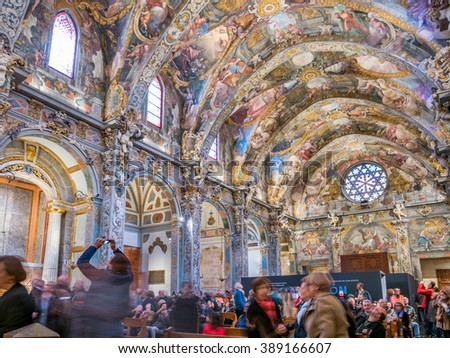 VALENCIA, SPAIN - FEBRUARY 28: Unidentified tourists enjoy a tour inside St. Nicholas Chapel (also known as Valencian Sistine Chapel) on February 28, 2016 - stock photo