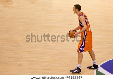 VALENCIA, SPAIN - JANUARY 28: Nando De Colo in action during the ACB league match between Valencia Basket  and Asefa Estudiantes, 85-71, on January 28, 2012, in Valencia, Spain - stock photo