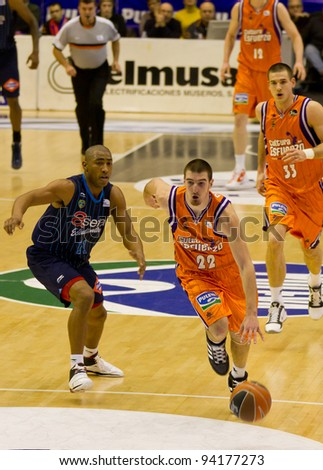 VALENCIA, SPAIN - JANUARY 28: Nando De Colo (#22) in action with the ball during the ACB league match between Valencia Basket  and Asefa Estudiantes, 85-71, on January 28, 2012, in Valencia, Spain - stock photo