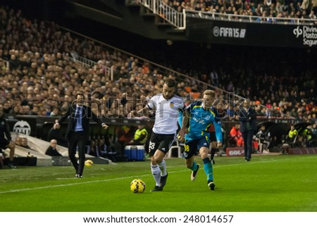 VALENCIA, SPAIN - JANUARY 25: Otamendi with ball during Spanish League match between Valencia CF and Sevilla FC at Mestalla Stadium on January 25, 2015 in Valencia, Spain - stock photo