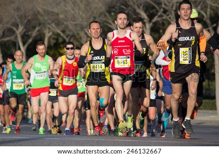 VALENCIA, SPAIN - JANUARY 11, 2015: Runners compete in the 2015 Valencia 10K Divina Pastora Run in Valencia, Spain. - stock photo