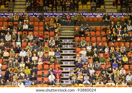VALENCIA, SPAIN - JANUARY 28: Supporters of Team Valencia Basket during the ACB league match between Valencia Basket  and Asefa Estudiantes, 85-71, on January 28, 2012, in Valencia, Spain - stock photo