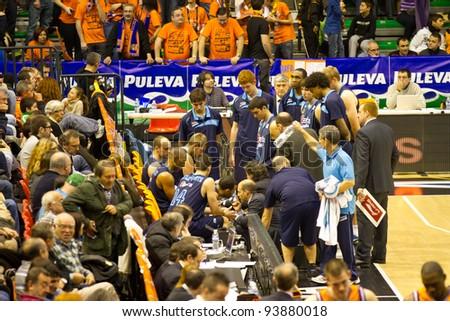 VALENCIA, SPAIN - JANUARY 28: Team Asefa Estudiantes preparing the strategy during the ACB league match between Valencia Basket  and Asefa Estudiantes, 85-71, on January 28, 2012, in Valencia, Spain - stock photo