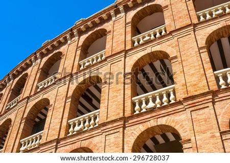 VALENCIA; SPAIN - JULY 14; 2015: Bull fighting arena- Plaza de Toros in Valencia. The stadium holds 10500 people. Was built in 1841 (arch. Sebastian Monleon) - stock photo