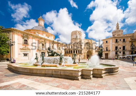VALENCIA, SPAIN - JULY 14: tourist in Virgin square with the Basilica of the Desamparados Virgin on July 14, 2014 in Valencia, Spain. It was built between 1652 and 1666.  - stock photo
