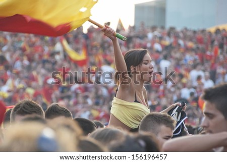 VALENCIA, SPAIN - JULY 11: Unidentified Spanish fans gather on a stadium to watch the TV translation of the final match of the World Cup 2010 in Valencia, Spain on July 11, 2010. - stock photo