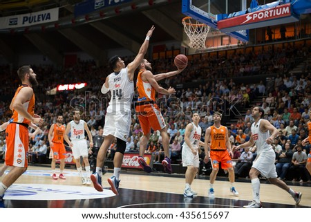 VALENCIA, SPAIN - JUNE 9th: Diot with ball and Ayon (14) during 4th playoff match between Valencia Basket and Real Madrid at Fonteta Stadium on June 9, 2016 in Valencia, Spain - stock photo