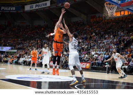 VALENCIA, SPAIN - JUNE 9th: Hamilton with ball and Thompkins during 4th playoff match between Valencia Basket and Real Madrid at Fonteta Stadium on June 9, 2016 in Valencia, Spain - stock photo
