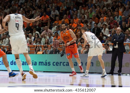 VALENCIA, SPAIN - JUNE 9th: San Emeterio wuth ball during 4th playoff match between Valencia Basket and Real Madrid at Fonteta Stadium on June 9, 2016 in Valencia, Spain - stock photo