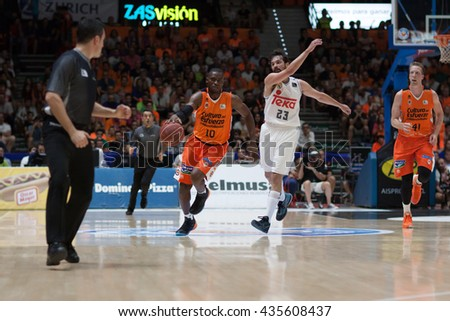 VALENCIA, SPAIN - JUNE 9th: Sato with ball and Llull during 4th playoff match between Valencia Basket and Real Madrid at Fonteta Stadium on June 9, 2016 in Valencia, Spain - stock photo