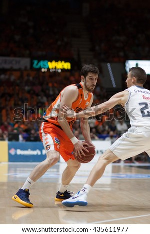 VALENCIA, SPAIN - JUNE 9th: Vives with ball and Carroll during 4th playoff match between Valencia Basket and Real Madrid at Fonteta Stadium on June 9, 2016 in Valencia, Spain - stock photo