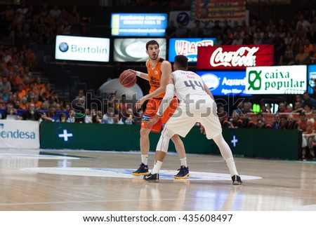 VALENCIA, SPAIN - JUNE 9th: Vives with ball and Taylor during 4th playoff match between Valencia Basket and Real Madrid at Fonteta Stadium on June 9, 2016 in Valencia, Spain - stock photo
