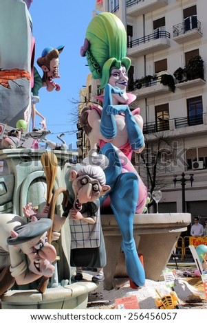 VALENCIA, SPAIN - MARCH 16, 2014: Fallas or Falles Monuments created to celebrate St. Joseph, on March 16, 2014 in Valencia, Spain. Popular Festival of fire, satire, music and firecrackers. - stock photo