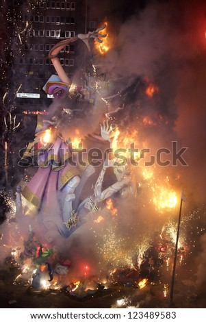 VALENCIA, SPAIN - MARCH 19: Las Fallas, where huge models are constructed and then burnt, a traditional celebration for Saint Joseph on March 19, 2007 of Valencia, Spain. - stock photo