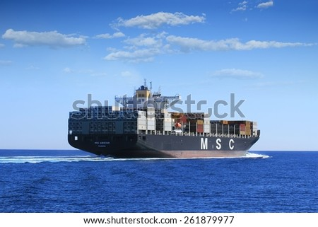 """VALENCIA, SPAIN   MARCH  07: The container ship """"MSC ABIDJAN"""" after leaving the port of Valencia is sailing in open waters, on march 07, 2015 in Valencia. - stock photo"""