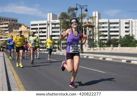 VALENCIA, SPAIN - MAY 15, 2016: Runners competing in the Volta a Peu Valencia Caixa Popular 8k run. Over 15,000 runners participated in this event. - stock photo