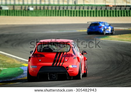 VALENCIA, SPAIN - MAY 2: Team formed by Nikolay Dmitriev and Nil Monserrat races in a Seat Leon Supercopa in the Spanish Endurance Championship, at Ricardo Tormo's Circuit, on May 2, 2015 in Cheste. - stock photo