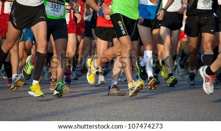 VALENCIA, SPAIN - NOVEMBER 27: Runners compete in the 31st Divina Pastora Valencia Marathon on November 27, 2011 in Valencia, Spain. - stock photo