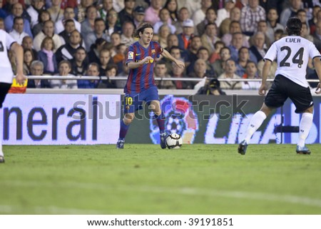 VALENCIA, SPAIN - OCTOBER 17 - Leo Messi - FootBall Match of Spanish Professional Soccer League between Valencia C.F. vs F.C. Barcelona - Mestalla Luis Casanova Stadium on October 17, 2009 in Valencia, Spain - stock photo