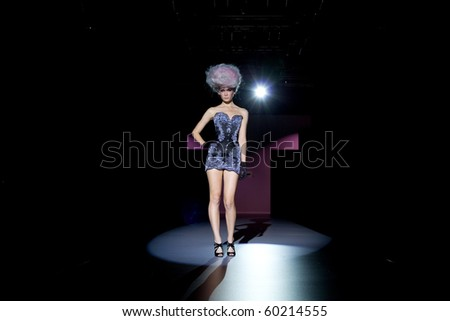VALENCIA, SPAIN - SEPTEMBER 1: A model on the catwalk wearing a Maya Hansen design for the Valencia Fashion Week on September 1, 2010 in Valencia, Spain. - stock photo