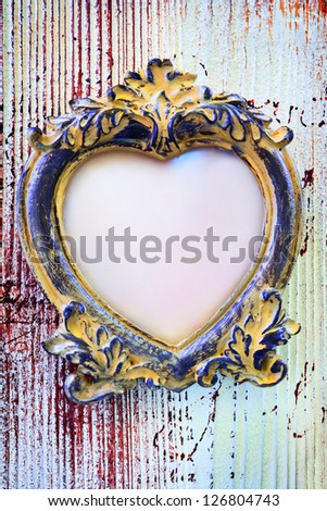 Valentine background - empty vintage frame in form of a heart - stock photo