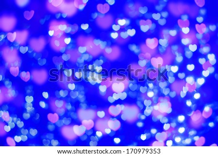 Valentine backgrounds. defocused pink blue lights in the shape of hearts - stock photo