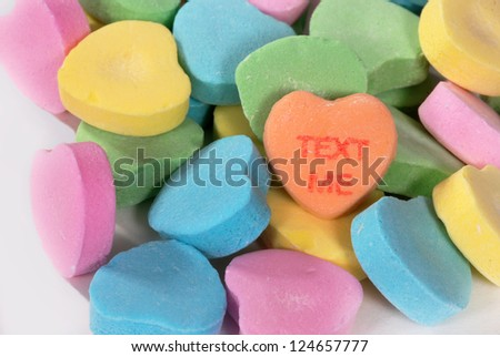 "Valentine candy hearts with ""Text Me"" saying - stock photo"