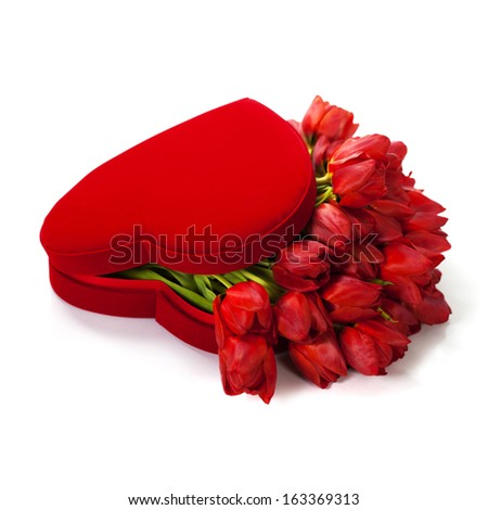 Valentine composition with red tulips in the box - stock photo