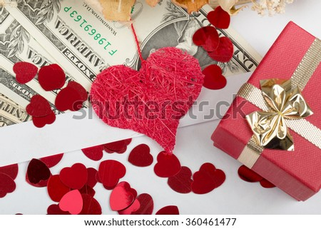 valentine concept with hearts, and us dollar banknotes as valentine present - stock photo