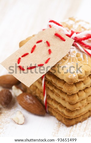 valentine cookies with heart tag and ribbon - stock photo